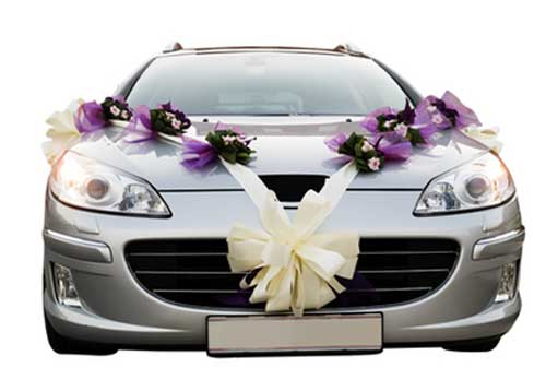 wedding car decorations - purple themed floral corsages