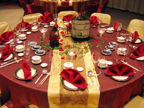 Gold and red wedding table setting.