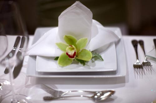 Here S An Example Of How One Gorgeous Green Cymbidium Orchid Can Be A Feature On Wedding Table The Is Placed White Plate In Front