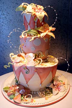 Three tier pastel pink and white whimsical and fun harlequin wedding cake design