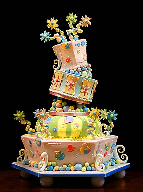 Green, yellow, blue and peach, four tier whimsical cake design