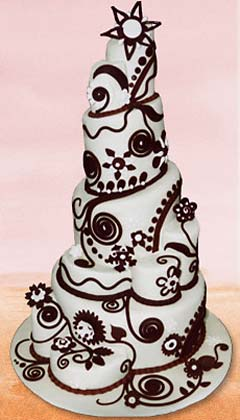 Five tier white and brown topsy turvy whimsical cake