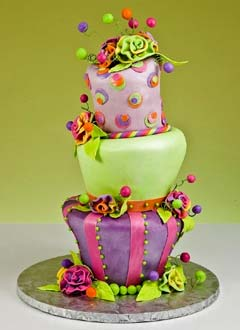 Pink, purple and green whimsical cake design created with a whimsical theme wedding