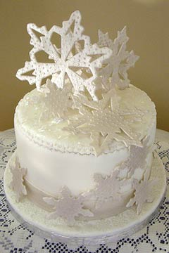 Single tier small winter white snowflake wedding cake
