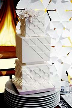 unique art deco white three tier 1920's and origami inspired wedding cake
