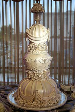 Ornate and intricate ivory wedding cake