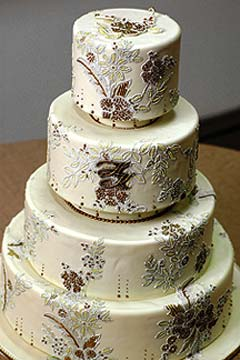 Four tier, brown and cream brocade wedding cake