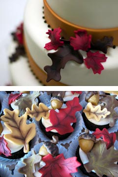 White three tier autumn themed wedding cake decorated with red, brown and tan hand crafted fondant leaves