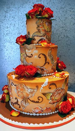 Three tier wedding cake hand painted and airbrushed in autumn theme earthy colours and decorations