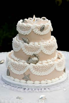 Three tier beige and white seashell cake