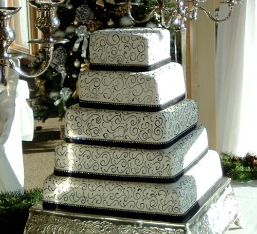 five tiered square black and white wedding cakes