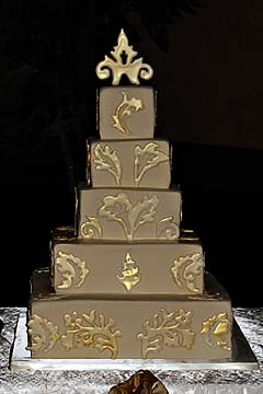 brown, bronze and gold wedding cake decorated with creative gold patterns