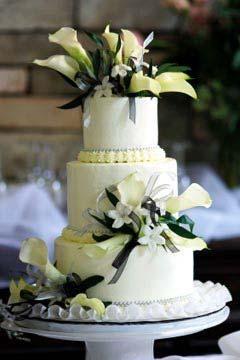 Three Tier Fresh Flower Wedding Cake With Calla Lily Topper And White Stephanotis
