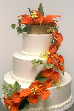 Three Tier Ercream Wedding Cake With Handmade Cascading Gumpaste Calla Lilies And Orange Topper