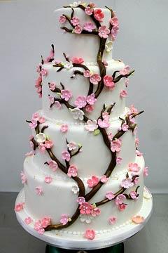 four tier round white cherry blossom wedding cake
