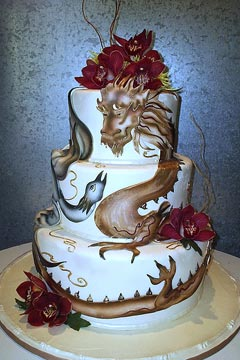 Three tier Chinese dragon and Phoenix wedding cake design, decorated with rich red Cymbidium Orchids