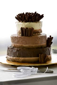 Three tiered chocolate flavoured cake; white, milk and dark chocolate