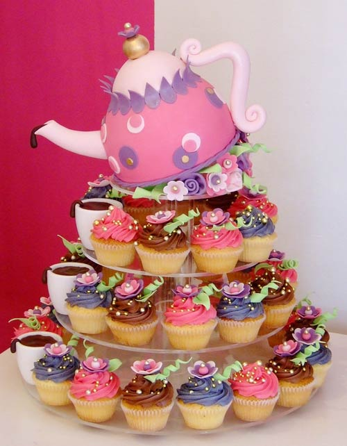 Four tiered pink and purple teapot novelty cupcakes