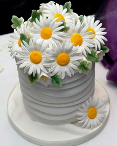 adorable small white fondant wedding cake decorated with white hand crafted gum paste daisies