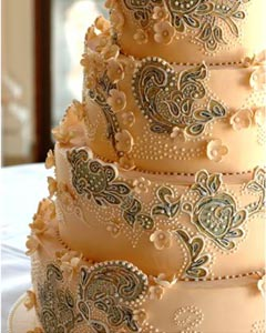 Four tier embroidery wedding cake. The wedding dress cake design based on a couture wedding dress