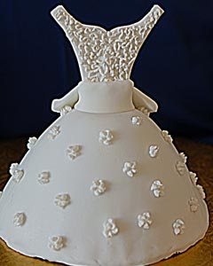 Simple and adorable white wedding gown cake decorated with features and pearly accents