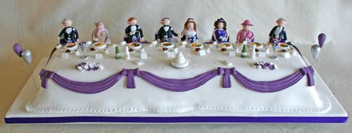 Novelty wedding cake with caricatures of the entire bridal party