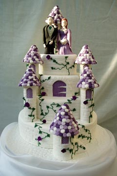 Four tier novelty white and purple Medievel wedding cake
