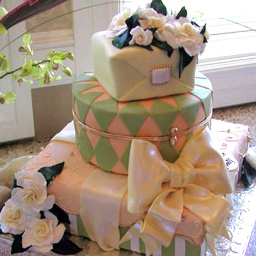Romantic wedding cake made to lool like a gift box wedding cake