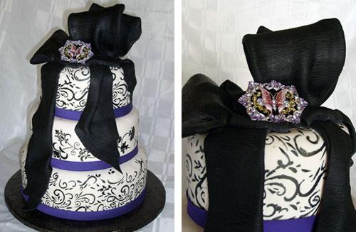 Striking three tier black and purple Gothic style wedding cake drapped with black fondant ribbon