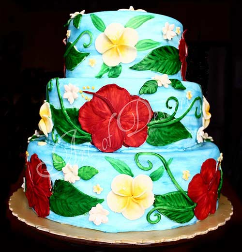 Tropical three tier hand painted hawaiian theme wedding cake design. Decorated in blue, red, green and yellow