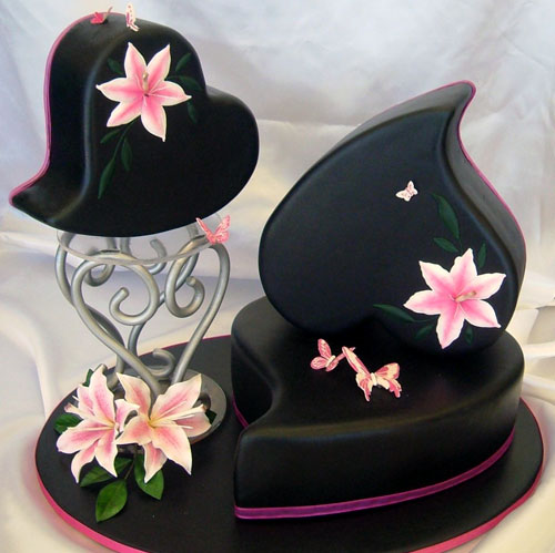 Three heart shaped black wedding cakes