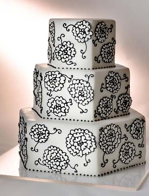 Three tier hexagon shaped black and white wedding cake