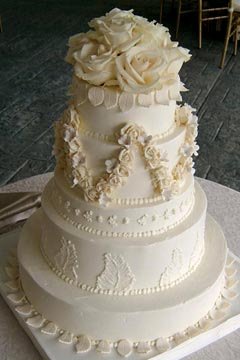 Traditional, five tier ivory buttercream classic style wedding cake