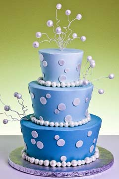 Three tier blue polka dot mad hatter wedding cake design