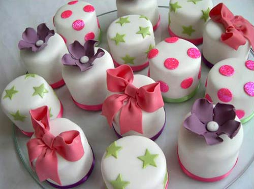 purple, green, pink and white miniature wedding cakes