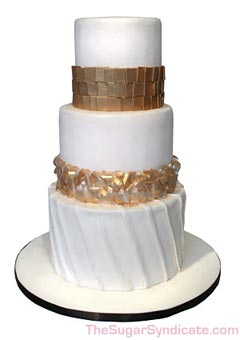 Contempory three tier white and gold wedding cake
