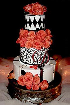 three tier black and white wedding cake decorated with orange roses