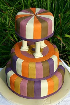 Three tier art deco white, green, purple, orange and yellow wedding cake