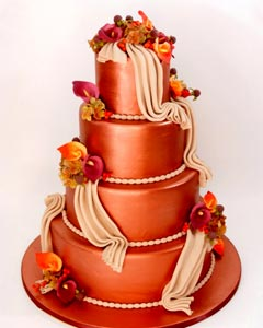 Four tier burnt orange wedding cake