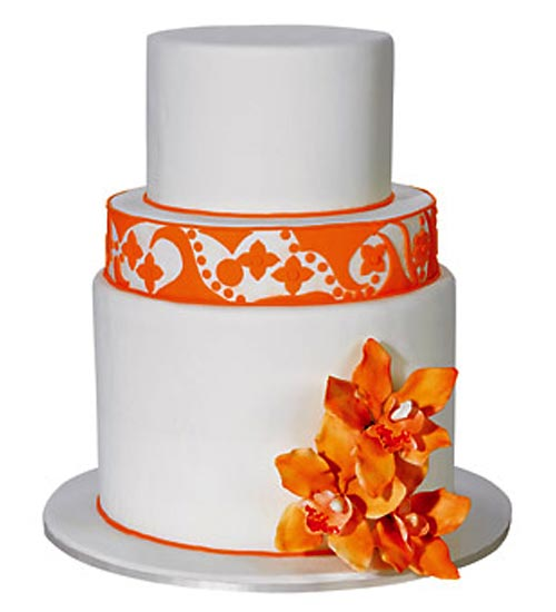 Two tier white and orange retro wedding cake