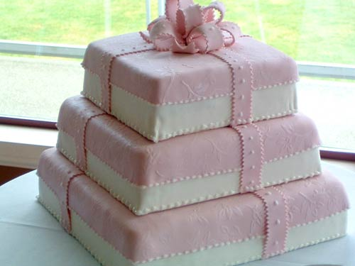 three tiered square pink gift box wedding cake