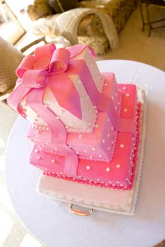 square four tier pink and white fondant wedding cake made to look like a present