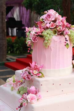three tier white and pink buttercream cake