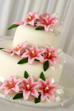 classic two tier white fondant wedding cake with tiger lillies