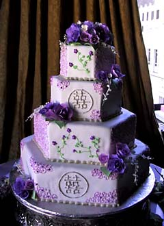 Four tier hexagon shape purple oriental wedding cake, decorated with intricate purple decorations