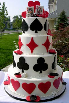 unique four tier red and white wedding cake decorated with black and red