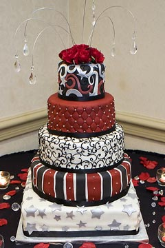 Unusual white and red five tier wedding cake
