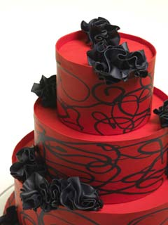 Red wedding cakes are as striking as they are unexpected. Usually complimented with contrasting colours