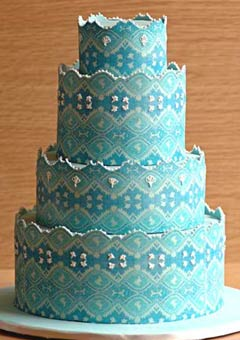 Four tier cool blue retro style wedding cake inspired by the brides blue laced gown