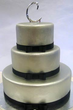 Three tier silver and black round fondant wedding cake